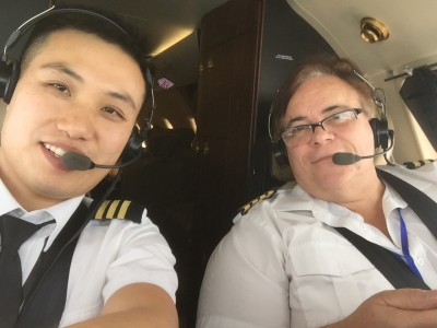 Shiyi Wang co-pilot with his Captain